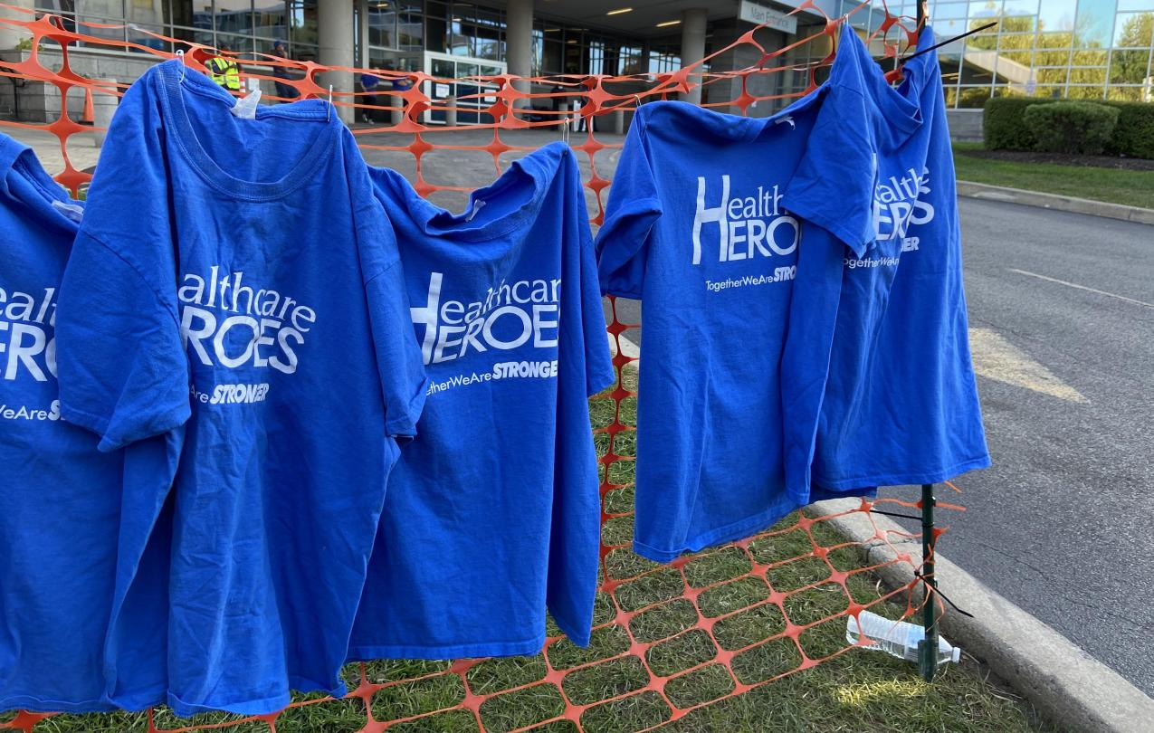 Healthcare Heroes t-shirts hanging up outside of Mercy Hospital