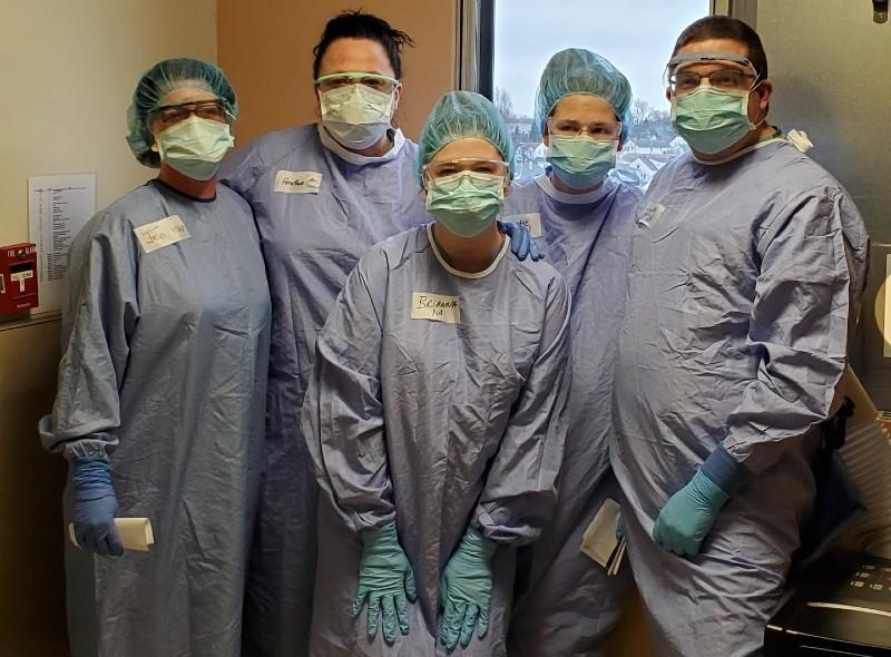 Group picture Catholic Health Healthcare Workers with scrubs, masks, gowns, goggles